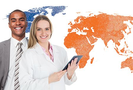 a man in a suit and a woman in a lab coat holding a clipboard standing in front of an orange and blue map of the world